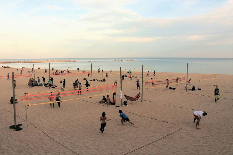 Beach Large Group Of People Sea Sunset Enjoyment Outdoors Sand Day Nature Horizon Over Water People Sky Adults Only Adult Barcelonabeach Barcelona Sea SandySeries Seaside_collection Eyem Gallery Sports Sport In The City Volleyball Net Volleyball Sand And Sea Seaview