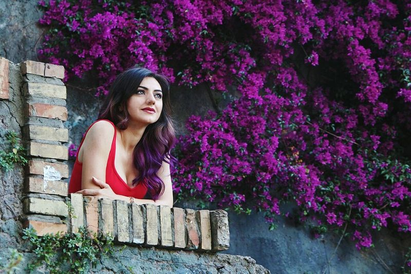 TakeoverContrast Flower Tree Long Hair Young Women Freshness Fragility Young Adult Lifestyles Standing Nature Springtime Person Beauty In Nature Violet Purple Purple Flower Purple Hair Violet Flowers Violet Hair Red Dress Woman Portrait Woman In Red Lookingup Serenity
