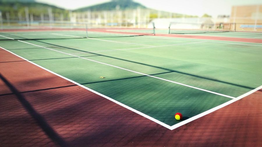Sport Competition Playing Field Tennis Court Competitive Sport Green Color Single Line Focus On Foreground Day The Color Of Sport Multi Colored Green Color Red Dividing Line The EyeEm Collection