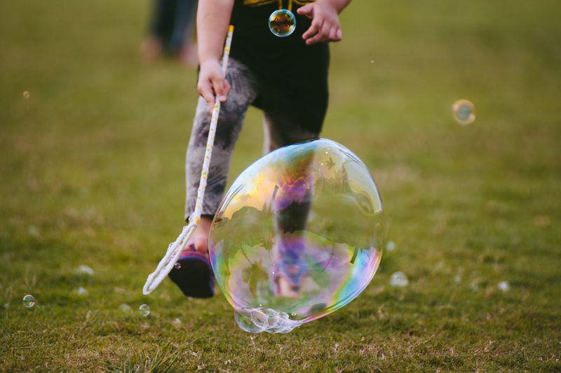 Bubble Bubbles Casual Clothing Close-up Day Enjoyment Envision The Future Field Focus On Foreground Fragility Fun Grass Grassy Green Color Lawn Leisure Activity Lifestyles Nature Outdoors Playing The Street Photographer - 2016 EyeEm Awards