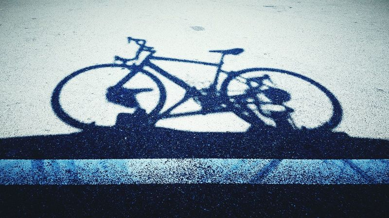 Thinks100 day 57. Shadow Shadows And Light Bicycle On The Road Sunny Day Things On The Ground Ferry