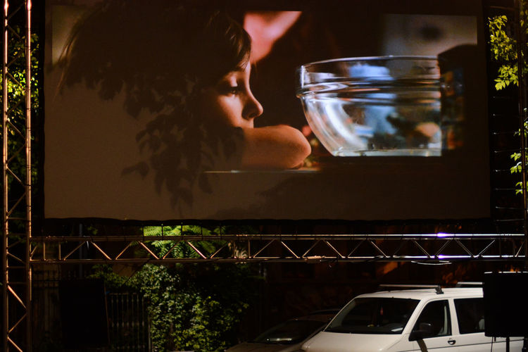 Fish Bowl Outdoor Cinema Young Boy HUAWEI Photo Award: After Dark Bucureşti Night Lights Cinema Illuminated Street Delivery