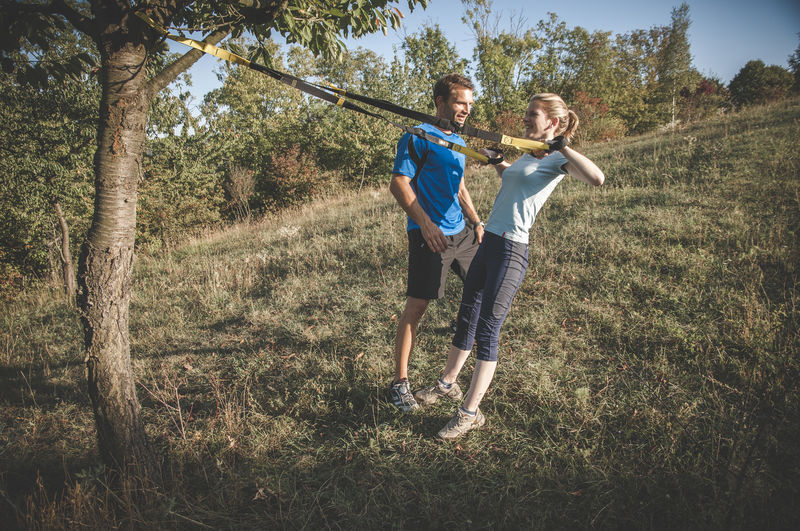 Personal Training Excercising Man Personal Training Woman Fit Fitness Fitness Training Full Length Leisure Activity Lifestyles Outdoors Personal Trainer Real People Sport Sports Clothing Strenght Training Together Togetherness Training Two People