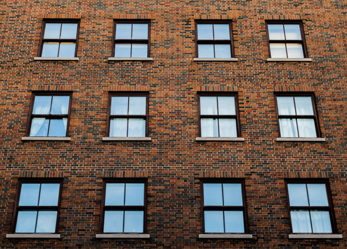 Apartment Architecture Backgrounds Brick Building Building Exterior Built Structure Day Full Frame Glass - Material In A Row Low Angle View No People Old Outdoors Pattern Repetition Residential District Side By Side Wall Window Window Frame