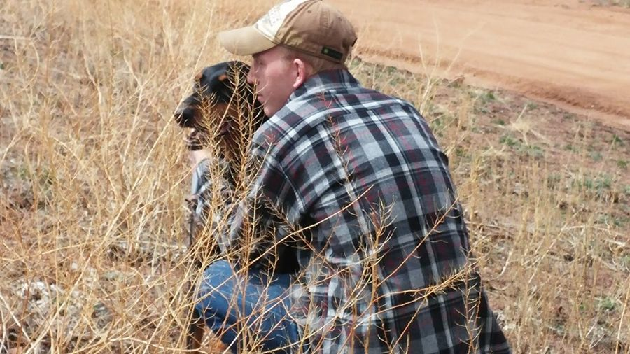 A Man And His Dog Real People Nature Plaid Shirt  Mansbestfriend Only Men Farmer Real People Lifestyles Adults Only Field Rear View Cereal Plant One Person Agriculture Low Section One Man Only Men Nature Young Adult Outdoors People Adult Day