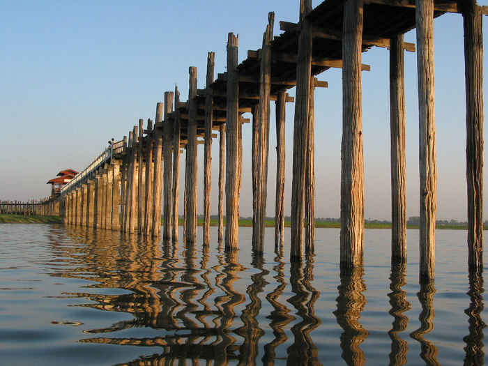 Rustic wooden bridge over taungthaman lake