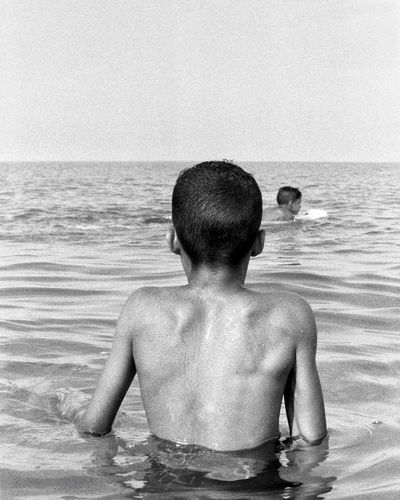 Film Photography EyeEm Water Childhood Child Shirtless Boys Sea Males  Rear View Vacations Horizon Over Water Outdoors