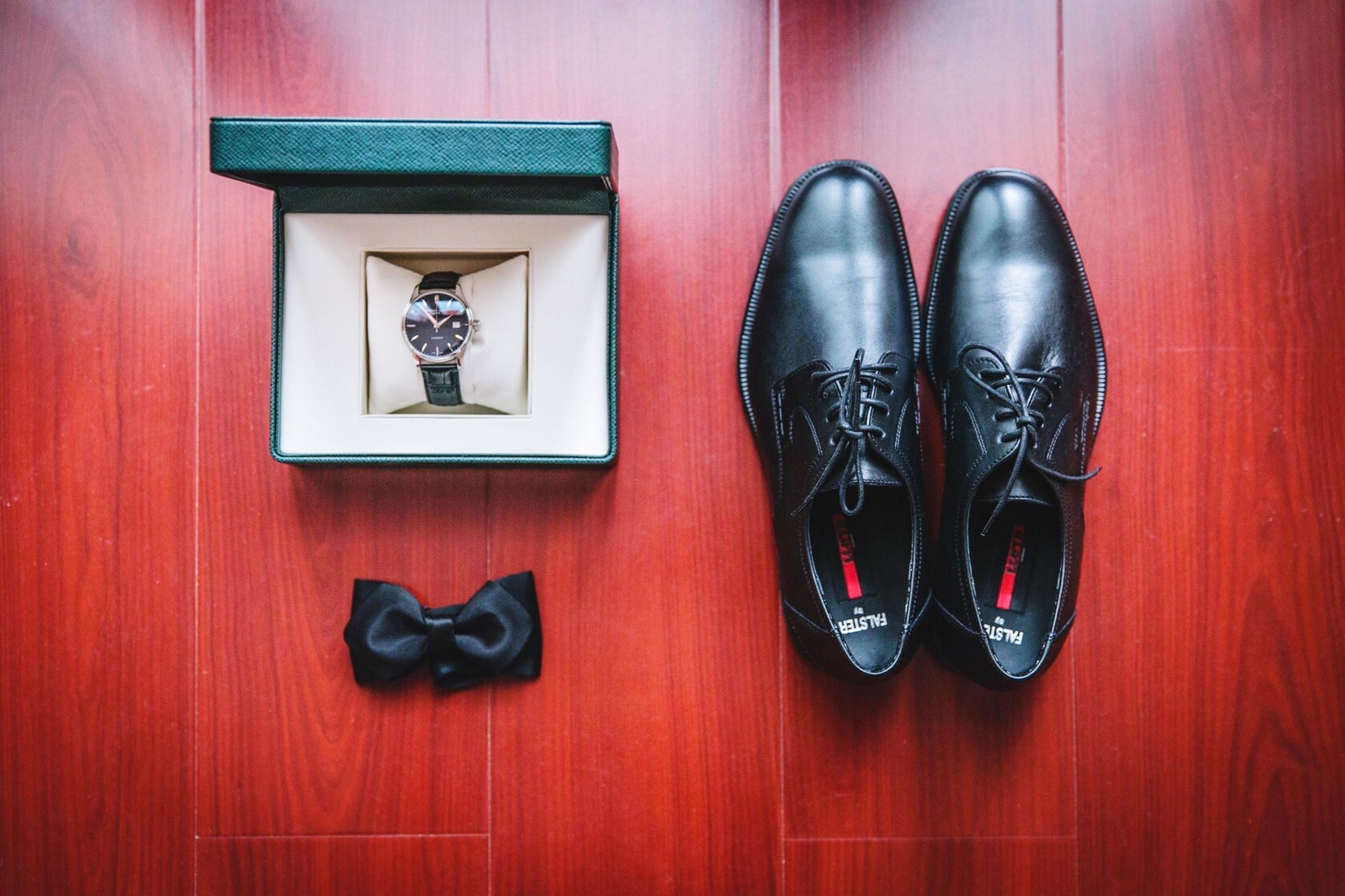 shoe, indoors, footwear, pair, low section, person, still life, red, high angle view, flooring, fashion, close-up, floor, directly above, table, wood - material, canvas shoe, two objects, human foot, shoelace