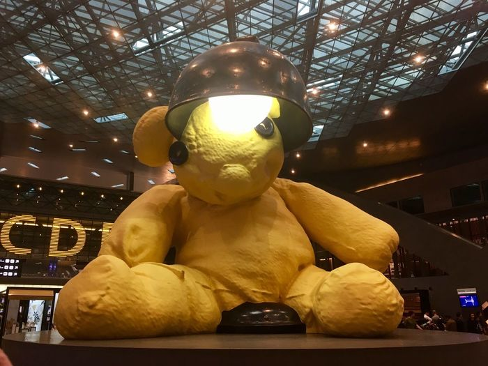 Doha Doha Hamadan Airport Airport Sculpture Lover Sculpture Gigantic Colors Color Yellow Teddy Bear Airport Sculpture No People Shopping Mall Lamp Light Indoors  Art ArtWork Huge Paint The Town Yellow