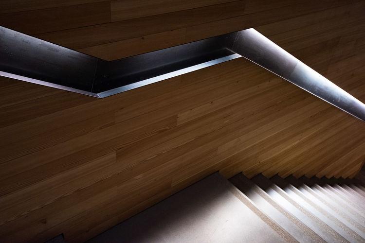 High angle view of piano on hardwood floor