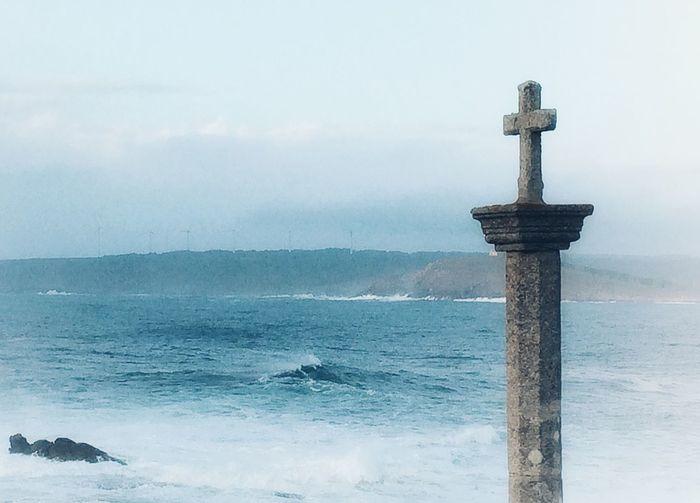 Cross on the edge. Muxía Atlantic Coast EyeEm Turbines Photooftheday Water Sea Horizon Over Water No People Sky Day Outdoors Nature Beauty In Nature Scenics