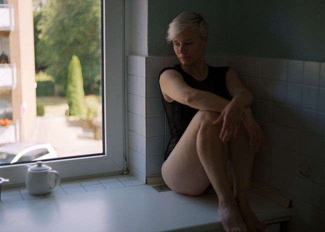 One Person Sitting Full Length Indoors  Young Adult Beauty Lifestyles Home Interior Window Real People Women Adult Beautiful Woman Clothing Home Young Women Domestic Room Flooring Contemplation Lingerie Hairstyle Analogue Photography Mediumformat