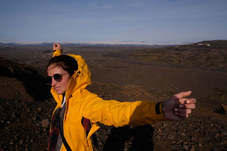 I'm inspired by inhaling fresh air and enjoying the beauty. Let freedom into oneself. Girl in the mountains. Tracking. Iceland Iceland Memories Adventure Beauty In Nature Day Iceland Trip Iceland_collection Icelandic_explorer Icelandtrip Landscape Leisure Activity Lifestyles Love Yourself Mountain Nature One Person Outdoors People Portrait Sky Sunglasses Vacations Yellow Young Adult Young Women Moments Of Happiness International Women's Day 2019
