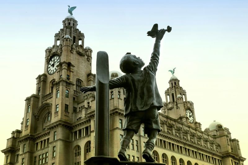 The Blitz memorial sculpture & the Liverbuilding. Liverpool. Photo Photography Architecture Remembrance Plane Boy Bronze The Blitz Liverbuilding  Liverpool Built Structure Building Exterior Architecture Sky Low Angle View Building Art And Craft Sculpture No People Statue Human Representation Place Of Worship Belief Outdoors