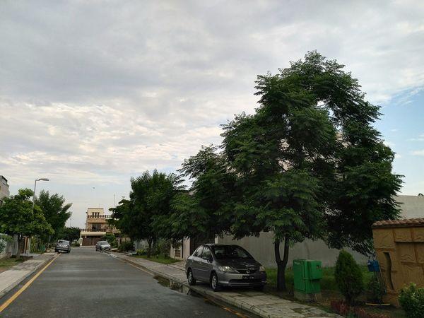 Road Street Homely Green Clouds And Sky Clouds This Week On Eyeem EyeEm Gallery Outdoors Honor5x EyeEm Nature Lover EyeEmBestPics