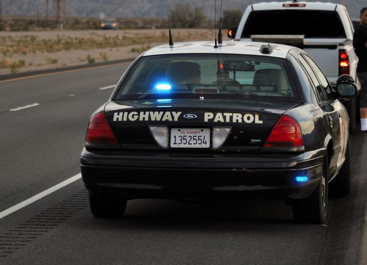 Highway patrol car behind a white truck Car Cockpit Day Mode Of Transport No People Outdoors Police Car Police Force Racecar Transportation