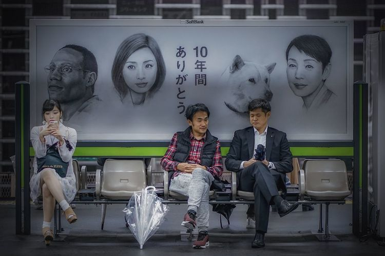 Japan Photography Tokyo Adult Architecture Casual Clothing Communication Digital Composite Front View Full Length Group Of People Human Representation Indoors  Male Likeness Males  Men Metro Station People Portrait Real People Representation Sitting Train Station Women Young Adult Young Men