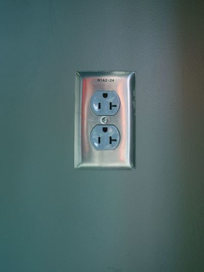 Close-up of electric sockets on the wall