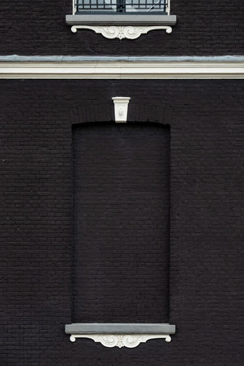 Amsterdam Brick Wall Façade Minimalist Architecture The Week on EyeEm Architecture Art And Craft Brick Wall Built Structure Close-up Copy Space Day Electric Lamp Flooring Indoors  Lighting Equipment No People Picture Frame Shelf Single Object Still Life Table Wall Wall - Building Feature Wood - Material The Architect - 2018 EyeEm Awards