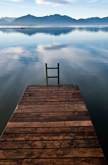 Jetty In Lake Against Sky