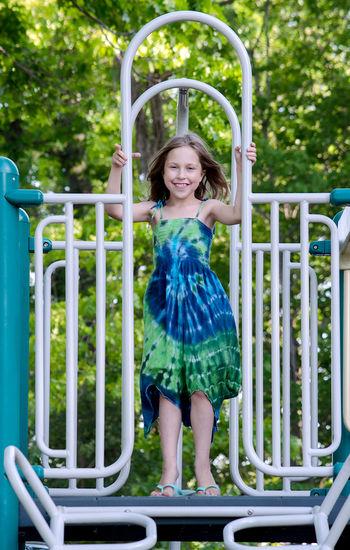 Portrait of smiling girl on railing