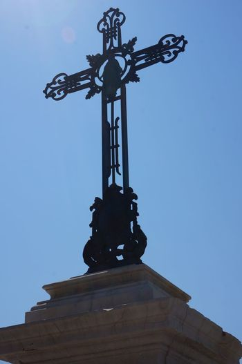 The Magic Mission Low Angle View Sculpture Silhouette Religion Outdoors No People Crusifix Symbol Symbolism Symbol Of Belief Metal Cross Cross View From Below