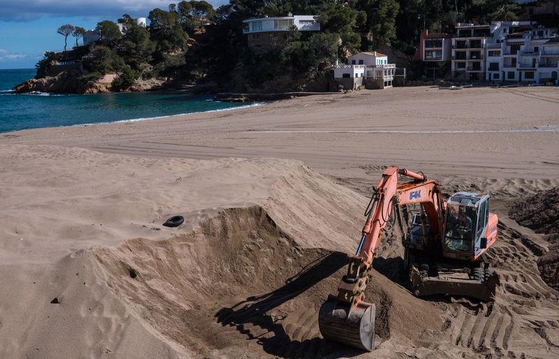 How real men build sandcastles on the beach :-) Beach Begur Costa Brava Excavator Sand Sandcastles Sea