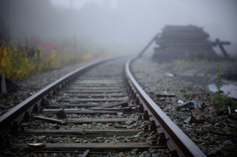 Railroad tracks in foggy weather