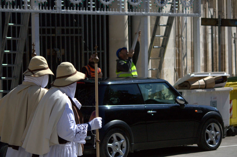 Penitente people walking on street at francavilla fontana
