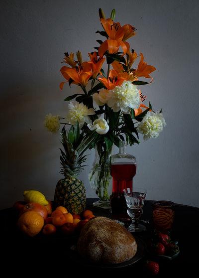Orange flower vase on table