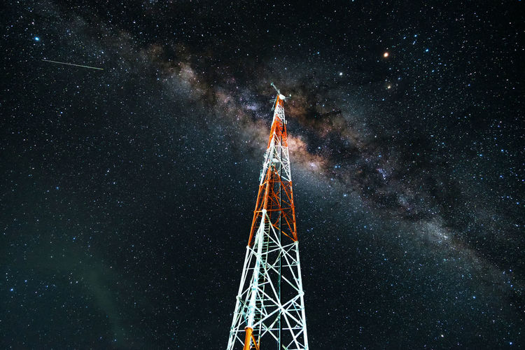 Milky way across the telecom tower in Sembalun, Lombok. Astronomy Beauty In Nature Blue Constellation Dark Galaxy Glowing Illuminated Low Angle View Milkyway Nature Night No People Outdoors Scenics Shooting Stars Sky Stargazer Tall - High Telecommunications The Great Outdoors - 2016 EyeEm Awards The Great Outdoors With Adobe Tower