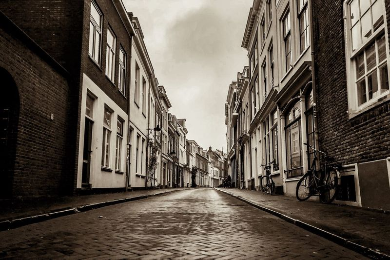 """""""Cities are not a concrete jungle, they are a human zoo"""" - Desmond Morris Follow on instagram: @andreaschrys _____________________________________________ #Netherlands #Utrecht #travel #photography #urban #marketing #inspiration #photographer #Nikon #nikonphotography #media #winter #communications #explore Building Exterior Built Structure Architecture Direction The Way Forward City Building Sky Street Diminishing Perspective Day Residential District Nature Outdoors vanishing point No People Transportation Alley Empty Road"""