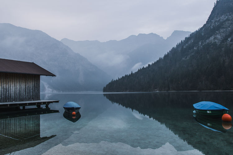 Calm sunrise at Lake Plansee in Tirol, Austria Reflection Water Lake Beauty In Nature Scenics - Nature Mountain Tranquility Tranquil Scene Nature Waterfront Sky Non-urban Scene Fog Mountain Range Outdoors Plansee Tirol  Austria Sunrise Calm Lake Reflection Silence Tranquility Calmness Calm Water My Best Photo