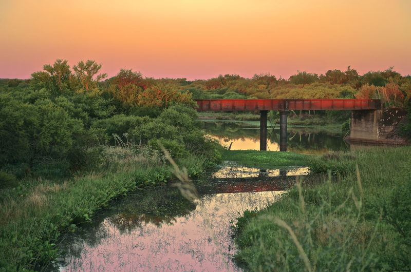The red bridge and the gorgeous sky Water Plant Sky Nature Tranquility Tree Reflection Lake Sunset Tranquil Scene Scenics - Nature No People Environment Landscape Beauty In Nature Grass Land Rural Scene Growth Outdoors Bridge Outdoor Photography Nature Photography EyeEm Nature Lover Sunset_collection