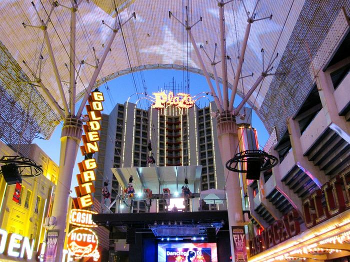 Freemont Street Experience Tourist Attractions Las Vegas Nevada Architecture Built Structure Building Exterior Low Angle View City Modern Travel Destinations Skyscraper City Life Tourism Famous Place Tall - High Arch Sky Office Building Outdoors Capital Cities  Spire  International Landmark Day