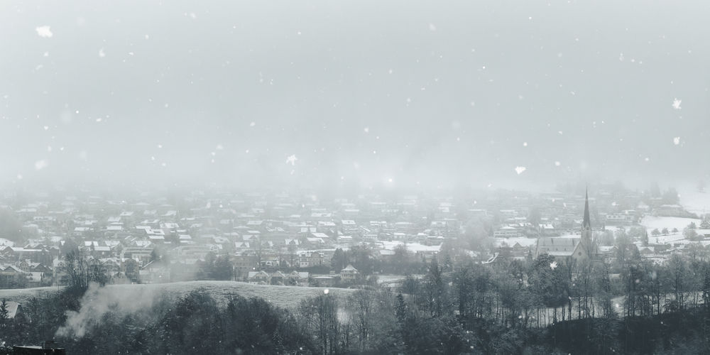 landscape of village in winter season Building Exterior Architecture Village Cityscape Nature Fog Winter Snow Snowfall High Angle View Outdoors Cold Temperature Snowing Sky Nature Building Church Panoramic Panorama Mist Copy Space