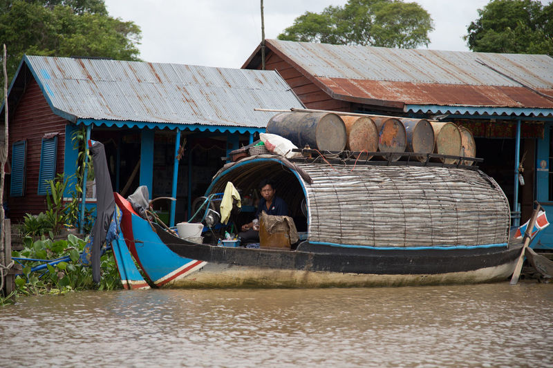 Man in boat against sky