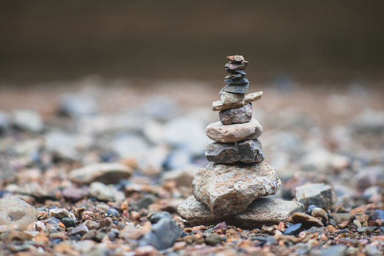 Stack of rocks on pebble over the bank of the river. Balance, harmony and Zen concept. Meditation Nature Relaxing Rock Stack Tranquility Wellness Aroma Balance Beach Close-up Focus On Foreground Gravel Harmony Massage Nature No People Outdoors Pebble River Rock - Object Stack Still Stone Zen