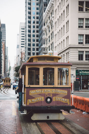 Architecture Building Exterior Built Structure Bus Cable Car City Day Double-decker Bus Land Vehicle Mode Of Transport Outdoors Public Transportation Real People Spring Street Tram Transportation