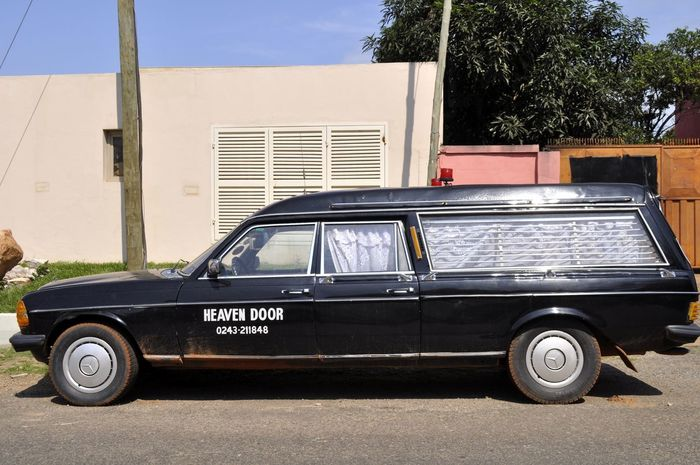 Heaven Door Africa African Car Dead Body Developing Country Device Funeral Funeral Home Funeral Tradition Ghana Ghanaian Heaven Heavens Door Mortician No People Outdoors Parked Road Slogan The Week On Eyem Themed Transportation Undertaker  Vehicle Vintage Car