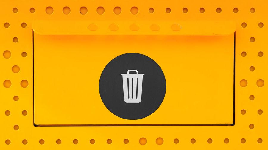 Full frame shot of yellow sign on metal