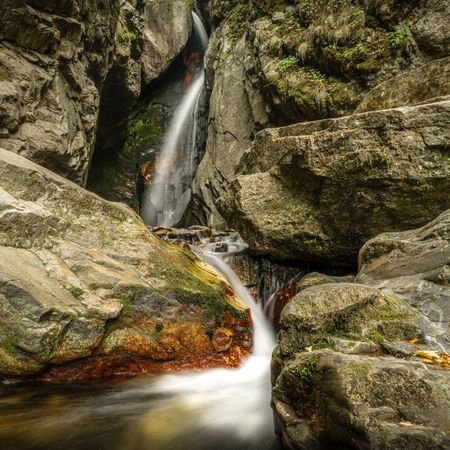 The bigger waterfall on Fotinovska river in the Rhodope mountain flows between some colourful rocks. Bulgarian Nature Curves Red Rhodopes Bulgaria Daylight Forest Long Exposure Moss Mountain Rocks Summer Water Waterfall