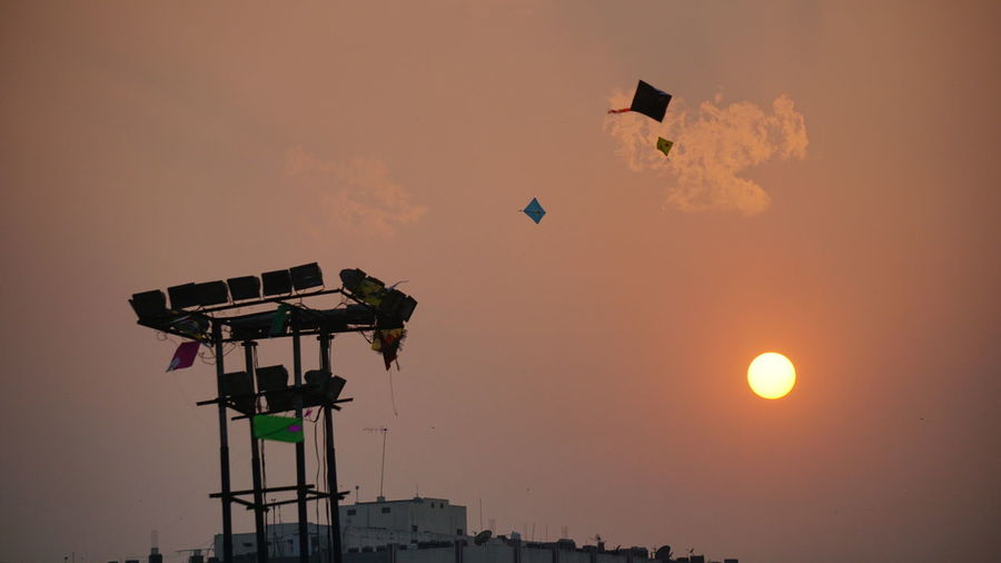 Evening sky during International Kites Festival at Hyderabad India on 15th January 2018 Sony A6000 Nwin Photography International Kites Festival Kites Festival Evening Evening Sky Kites And Sun Orange Sky Orange Sky And Orange Sun EyeEm Selects Flying Mid-air Sunset Kite - Toy Hanging Silhouette Sky Celebration People Outdoors Day