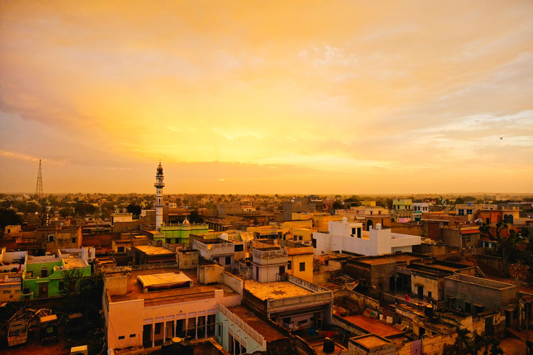 Sunset over old town old Mandawa, India. ASIA India Mandawa, Rajasthan Old Town Architecture Building Building Exterior Built Structure City Cityscape Cloud - Sky Crowd Crowded High Angle View Mandawa Nature Old City Orange Color Outdoors Residential District Romantic Sky Roof Settlement Sky Sunset Town TOWNSCAPE
