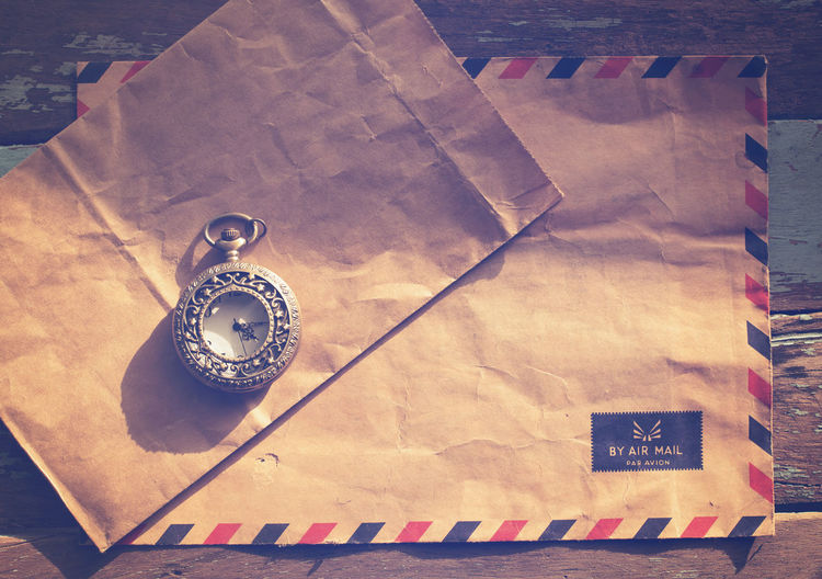 Vintage antique watches and airmail letter on wood table, instagram effect filter High Angle View Table Paper Antique Text Communication Retro Styled Old Directly Above Document Day Vintage Letter Retro Rustic Memories Nastalgia Remember Former