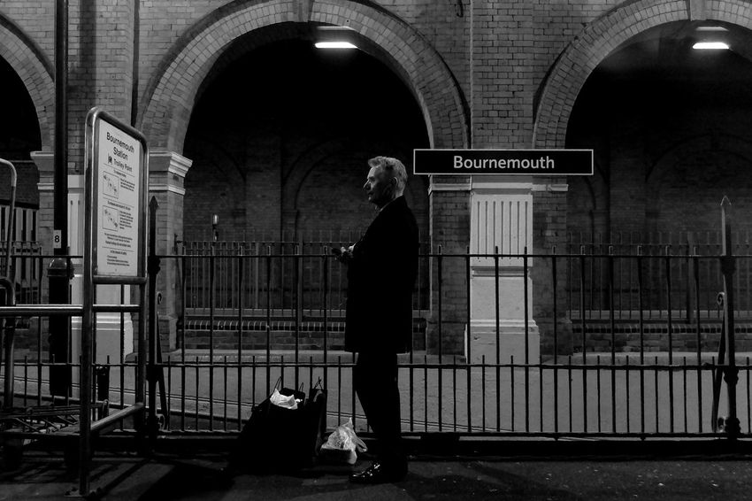 Waiting for the train at Bournemouth Central Station. Black & White Dorset After Dark Train Station
