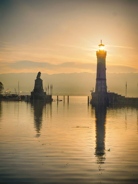 Lindau Harbour in Germany Harbour Lake Constance Lighthouse Lindau Lindau Bodensee Architecture Beauty In Nature Bodensee Building Exterior Built Structure Day Guidance Lake Lighthouse Nature No People Outdoors Reflection Scenics Sea Sky Sunset Tranquility Water Waterfront