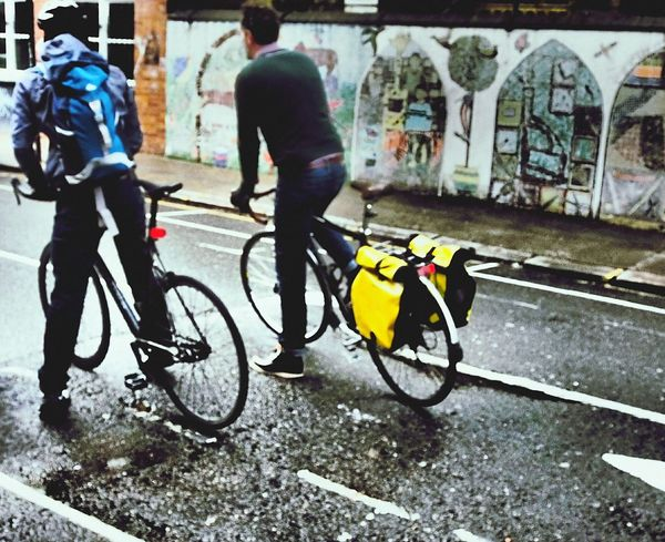 Bicycle Cycling Transportation Mode Of Transport Only Men Commuter City Outdoors LONDON❤ East London, UK Street Photography London Lifestyle Graffiti Art Rucksack London East End CyclingUnites Cyclists Cyclinglife Rainy Day Wet Street Road Bike