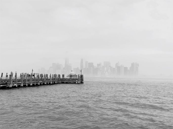 Sea Building Exterior Architecture Landing Stage Water Built Structure Skyscraper Outdoors Day City Cityscape Fog No People Sky Urban Skyline Nature New York City Manhattan Blackandwhite Black And White Black & White Distant