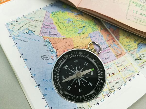 Lets travel and explore Map Multi Colored No People Time Indoors  Close-up Day Travel Explore Passport Outdoors Adventure Experience Minute Hand Travelling Compass